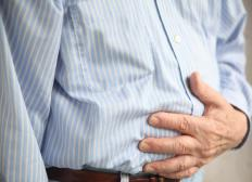 Symptoms of mild gastritis may include nausea and stomach discomfort.