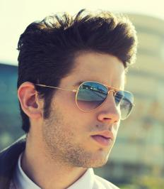 Polarized sunglasses are designed to reduce glare from light that is reflected off of surfaces like water or snow.