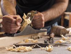 Craftsmen may demonstrate their work live at a woodworking show.
