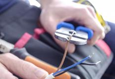 Electrical pliers allow electricians to strip away a wire's plastic insulation and expose bare metal wire.