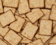 Small snacks, such as graham crackers, can make long travels without stops for meals easier.
