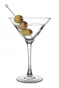An olive spoon may be used when making a martini.