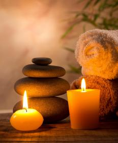 A couples massage may include hot stone treatments.