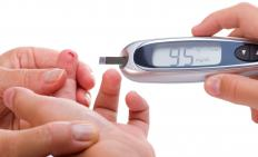 Using a blood glucose meter.
