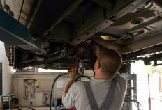 A two post hoist can be used to lift vehicles off the ground, allowing mechanics access to the undersides.