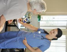 A medical assistant taking a patient's history in a family practice.