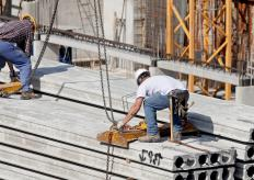Construction hoists are used to lift people or materials to various heights on a building project.