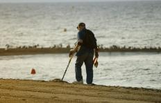 Beachcombers often use metal detectors to look for valuable objects.