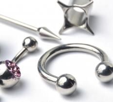 There are several different types of piercing jewelry, including studs and barbells.