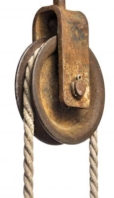 Storage hoists typically use one or more pulleys to lift heavy items.