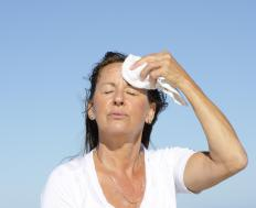 Menopausal women may experience hot flashes triggered by a hormonal imbalance.