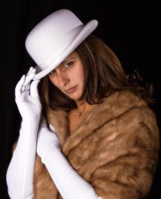 A mink stole is usually rectangular and wrapped around the shoulders.