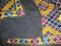 Mirror-work embroidering involves attaching lightweight mirrors to fabric with intricate embroidery.