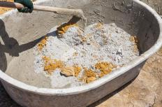 Sand or crushed rock and water is typically added to mortar to create cement.