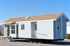 Mobile homes are often transported on flatbed trailers.