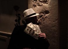 Shadowy figures offering bribes are one common trope in the mystery genre..