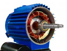 The asynchronous motor's cylindrical core provides rotational drive.