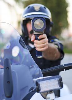 State troopers use radar guns to measure the speed of cars and trucks.