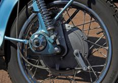 Older motorcycle shock systems used coiled springs.