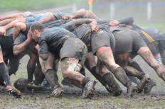 Muddy rugby scrum