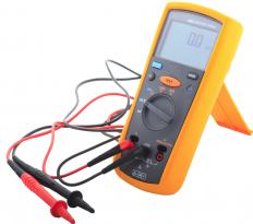 A multimeter with red and black cables.