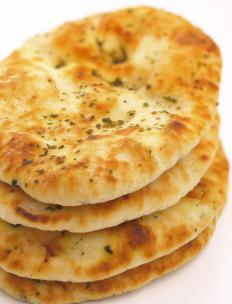 Naan is commonly served with dhal.