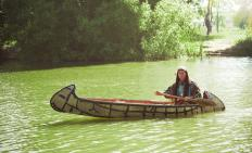 Paddlers usually sit on a thwart when traveling by canoe.