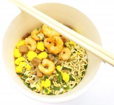 Asian shrimp and noodle dish cooked on a wok range.