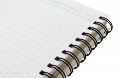 Notebook paper may contain microperforations for easy removal.