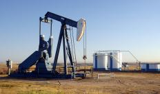 Petroleum engineering technicians locate potential oil wells.