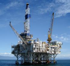 An offshore oil platform with a derrick.