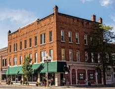 Buildings in a historic district may be repurposed for modern use while retaining their original appearance.