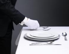 People may use charger plates to create an elegant dinner setting.