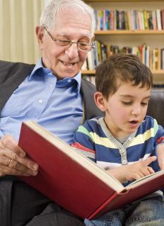 Grandparents often enjoy spending time with their grandkids for storytime.