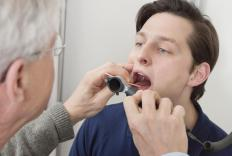 A mouth examination can identify some symptoms of mouth cancer.