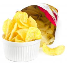 Potato chips are often served with bean dip at parties.