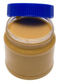 Monoglyceride acts as an emulsifier in processed peanut butter to keep the oil from separating and rising to the top.