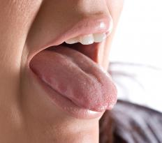 Throat infections may cause pus on the tongue.