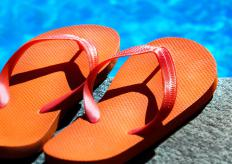 Rubber slippers, the popular beach sandal, also go by the names flip-flops and thongs.