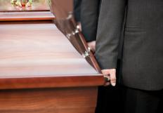 A pallbearer helps carry the casket during a funeral.