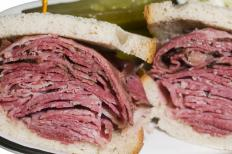 A sandwich made with pastrami, a cured lunch meat.