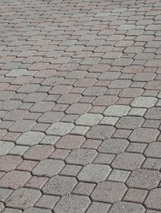 Concrete pavers tend to be more environmentally friendly than solid poured surfaces.