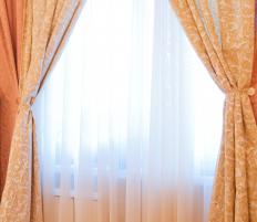 Curtain length and width are important, and curtains can pull back to expose sheers.