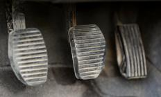 Clutch, brake and gas pedals are generally on the driver's side of a vehicle's footwell.
