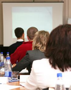 A director of marketing may give presentations to company executives.