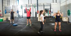 The clean and jerk and the snatch are two moves commonly performed with Olympic weightlifting bars.