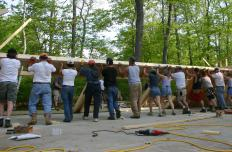 A barn raising is when members of a community work together to build a structure, typically for the benefit of the community or an individuals in need.