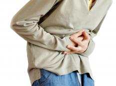 A stomach ache can be a sign of a tampon infection.