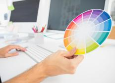 "A color wheel is disk-shaped and displays colors according to their ""pigment"" values."