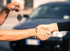 Dealerships typically have staff on hand to help with the transfer of car ownership.